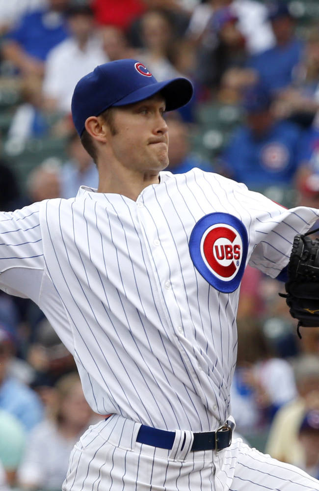 Chicago Cubs starting pitcher Scott Baker delivers during the first inning of a baseball game the Atlanta Braves Friday, Sept. 20, 2013, in Chicago
