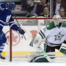 Toronto Maple Leafs center Trevor Smith, left, scores the game winning overtime goal on Dallas Stars goaltender Kari Lehtonen during an NHL hockey game, Thursday, Dec. 5, 2013 in Toronto The Associated Press