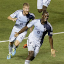 Sporting KC's Oriol Rosell (20) chases teammate Ike Opara, right, after he scores against Real Salt Lake in the second half during an MLS soccer game Saturday, July 20, 2013, in Sandy, Utah. Sporting KC defeated Real Salt Lake 2-1. (AP Photo/Rick Bowmer)