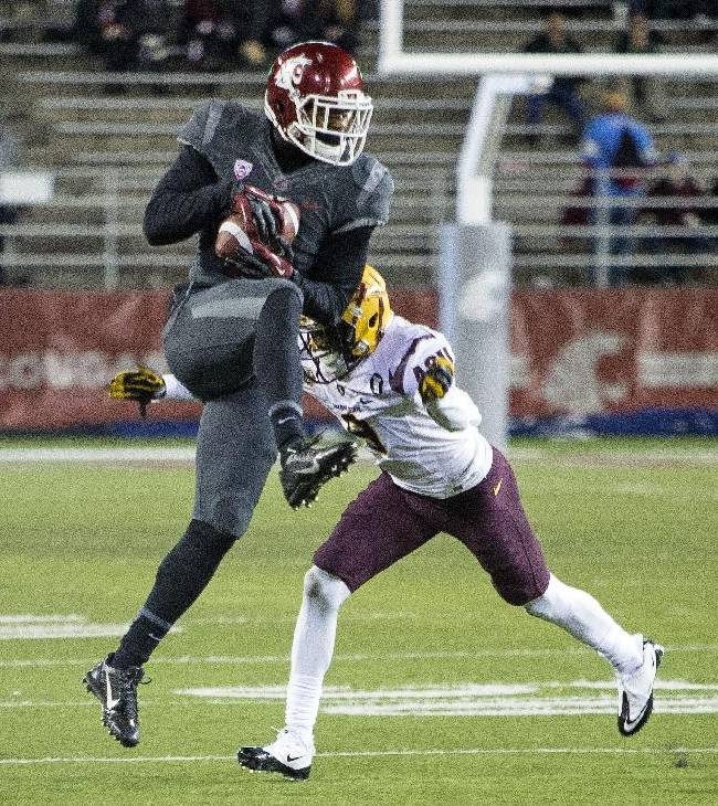 Washington State wide receiver Vince Mayle, left, catches a pass in front of Arizona State defensive back Robert Nelson, right, during the first half of an NCAA college football game on Thursday, Oct. 31, 2013, at Martin Stadium in Pullman, Wash