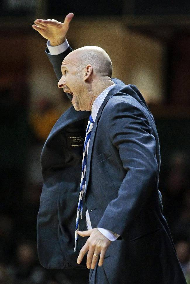 Mississippi head coach Andy Kennedy signals to his players in the first half of an NCAA college basketball game against Vanderbilt, Wednesday, Jan. 22, 2014, in Nashville, Tenn. Mississippi own 63-52