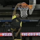 Wichita State's Cleanthony Early dunks the ball during practice for their NCAA Final Four tournament college basketball semifinal game against Louisville, Friday, April 5, 2013, in Atlanta. Wichita State plays Louisville in a semifinal game on Saturday. (AP Photo/Tim Donnelly)