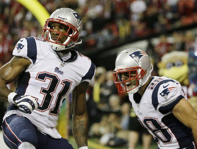 New England Patriots cornerback Aqib Talib (31) and New England Patriots strong safety Steve Gregory (28) react after Talib broke up the last Atlanta Falcons pass during the second half of an NFL football game, Sunday, Sept. 29, 2013, in Atlanta. The New England Patriots won 30-23