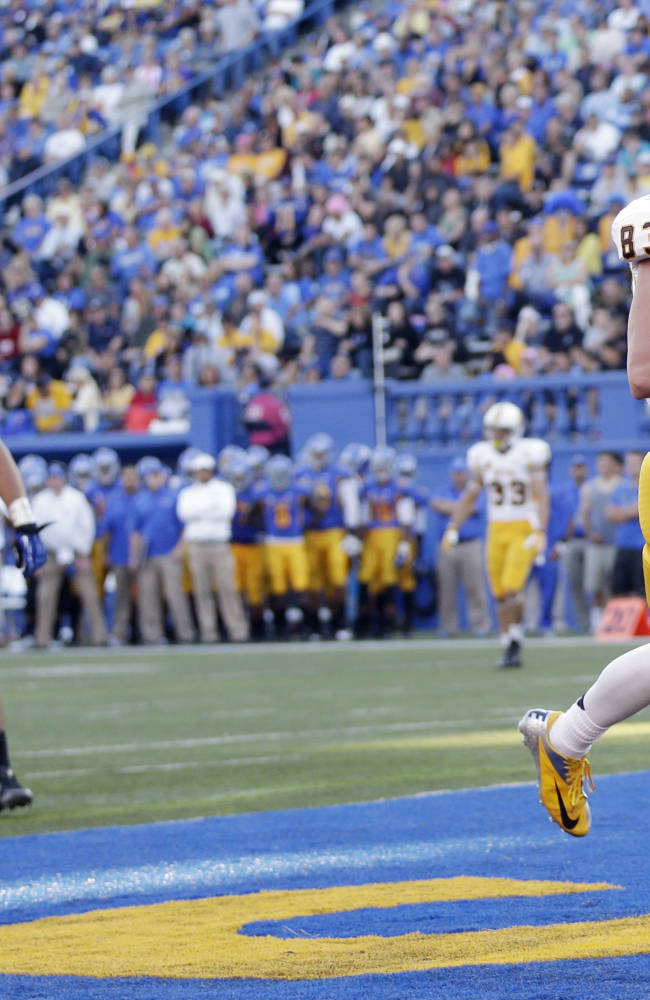 Wyoming wide receiver Jake Maulhardt celebrates his touchdown against San Jose State during the first half of an NCAA college football game on Saturday, Oct. 26, 2013, in San Jose, Calif