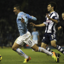 West Bromwich Albion's Claudio Yacob, right, concedes a penalty after his challenge on Manchester City's Aleksandar Kolarov during the English Premier League soccer match at The Hawthorns, West Bromwich, England, Wednesday Dec. 4, 2013. Manchester City wo