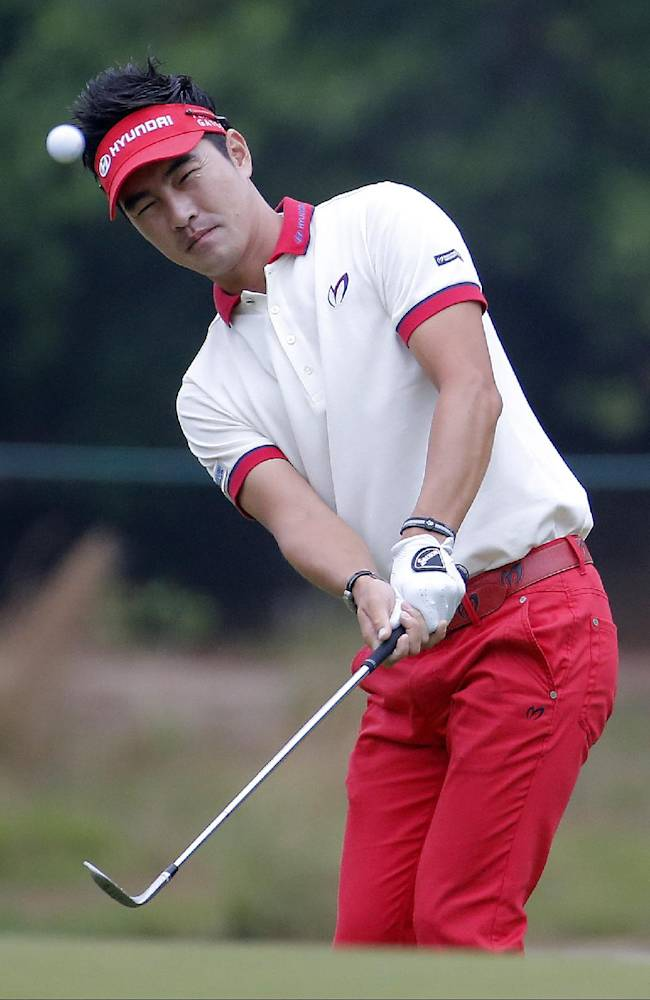 Hyung-Sung Kim, of South Korea, chips to the green on the second hole during the second round of the U.S. Open golf tournament in Pinehurst, N.C., Friday, June 13, 2014