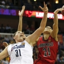 Louisville guard Bria Smith (21) blocks a shot against Connecticut center Stefanie Dolson (31) during first half of the national championship game of the women's Final Four of the NCAA college basketball tournament, Tuesday, April 9, 2013, in New Orleans. (AP Photo/Dave Martin)