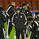 Real Madrid's coach Carlo Ancelotti, center, watches as his team train with teammates at Anfield Stadium, in Liverpool, England, Tuesday, Oct. 21, 2014. Real Madrid will play Liverpool in a Champion's League Group B soccer match on Wednesday