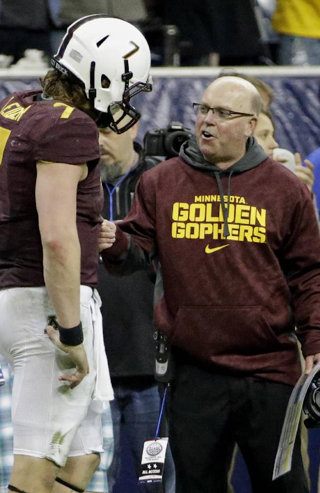 Minnesota coach Jerry Kill, right, talks with quarterback Mitch Leidner (7) during the second half of the Texas Bowl NCAA college football game against Syracuse, Friday, Dec. 27, 2013, in Houston. Syracuse won 21-17