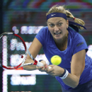 Petra Kvitova of the Czech Republic return a shot from Peng Shuai of China during the China Open tennis tournament at the National Tennis Stadium in Beijing, China, Wednesday, Oct. 1, 2014. (AP Photo/Vincent Thian)