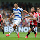 Queens Park Rangers' Rio Ferdinand, left, battles for the ball with Sunderland's Steven Fletcher during their English Premier League soccer match at Loftus Road, London, Saturday, Aug. 30, 2014
