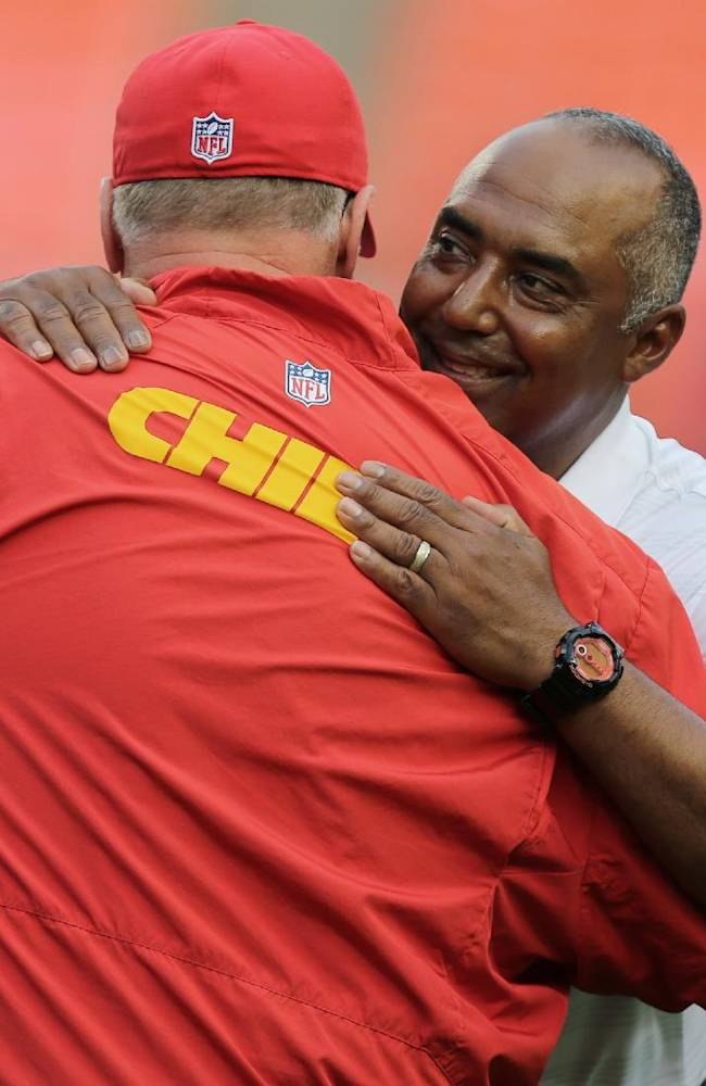 Cincinnati Bengals coach Marvin Lewis, right, hugs Kansas City Chiefs coach Andy Reid before an NFL preseason football game Thursday, Aug. 7, 2014, in Kansas City, Mo
