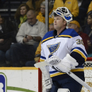 FILE - In this Dec. 4, 2014, file photo, St. Louis Blues goalie Martin Brodeur looks up at the scoreboard during a timeout in the first period of an NHL hockey game against the Nashville Predators in Nashville, Tenn. Brodeur, one of the greatest goaltenders in NHL history, is retiring. He starred for years with New Jersey Devils and is now with St. Louis. (AP Photo/Mark Zaleski, File)