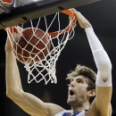 Kansas center Jeff Withey (5) dunks against Kansas State during the first half of the championship NCAA college basketball game of the Big 12 tournament Saturday, March 16, 2013, in Kansas City, Mo. (AP Photo/Orlin Wagner)