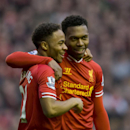 Liverpool's Daniel Sturridge, right, celebrates with teammate Raheem Sterling after scoring against Swansea City's during their English Premier League soccer match at Anfield Stadium, Liverpool, England, Sunday Feb. 23, 2014