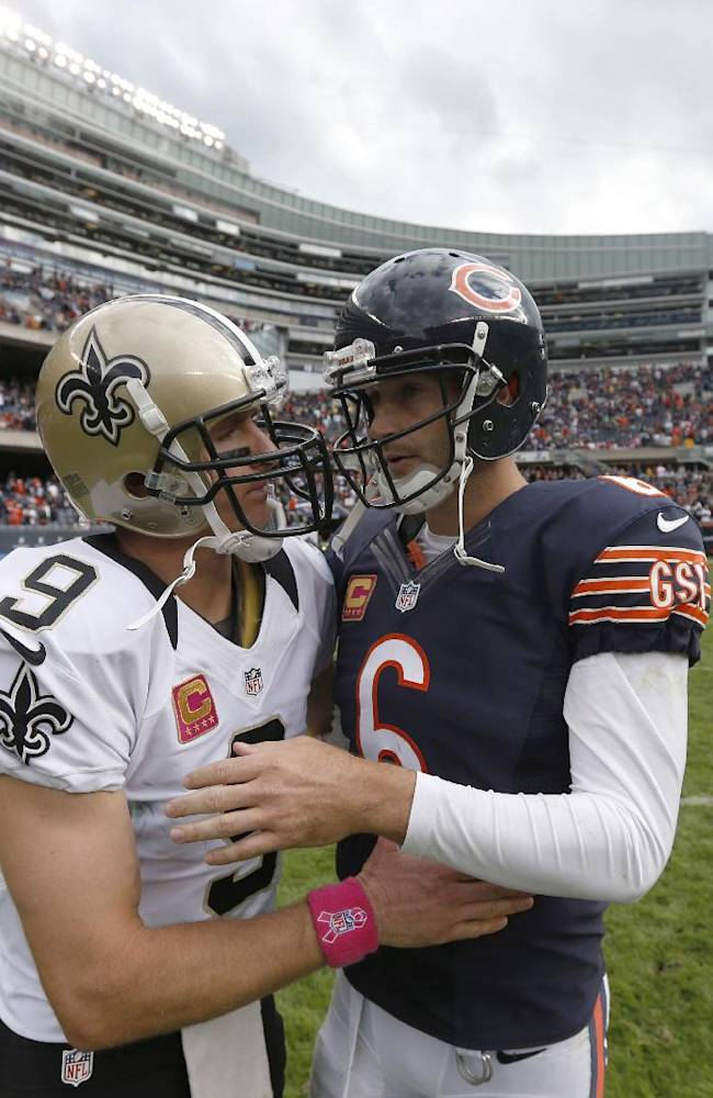 New Orleans Saints quarterback Drew Brees (9) and Chicago Bears quarterback Jay Cutler (6) talk after an NFL football game, Sunday, Oct. 6, 2013, in Chicago. Saints won 26-18