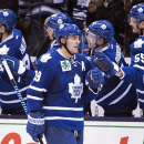 Toronto Maple Leafs' Joffrey Lupul celebrates with teammates after scoring a goal during the third period of an NHL hockey game, Saturday, Nov. 29, 2014 2014 in Toronto The Associated Press
