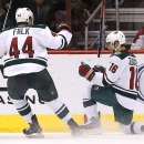 Minnesota Wild's Jason Zucker (16) celebrates his goal against the Arizona Coyotes with teammate Justin Falk (44) during the second period of an NHL hockey game Saturday, Dec. 13, 2014, in Glendale, Ariz The Associated Press