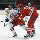 Carolina Hurricanes' Brad Malone (24) hits Columbus Blue Jackets' Will Weber (44) during the first period of an NHL preseason hockey game in Raleigh, N.C., Sunday, Sept. 21, 2014 The Associated Press