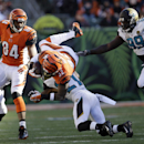 Cincinnati Bengals running back Jeremy Hill, center, top, flips over Jacksonville Jaguars' Toby Gerhart during the second half of an NFL football game in Cincinnati, Sunday, Nov. 2, 2014 The Associated Press