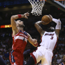 Washington Wizars' Marcin Gortat (4) blocks a shot by Miami Heat's Dwyane Wade (3) during the first half of an NBA basketball game, Monday, March 10, 2014, in Miami The Associated Press