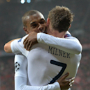 Manchester City's Fernandinho, left, and Manchester City's scorer James Milner, right, celebrate their side's third goal during the Champions League group D soccer match between FC Bayern Munich and Manchester City, in Munich, southern Germany, Tuesday, D