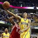 Indiana Pacers guard George Hill (3) shoots after getting past Houston Rockets forward Terrence Jones (6) in the second half of an NBA basketball game in Indianapolis, Friday, Dec. 20, 2013. (AP Photo/R Brent Smith)