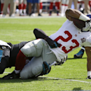 New York Giants running back Rashad Jennings (23) is brought down by Jacksonville Jaguars outside linebacker Geno Hayes after a short gain during the first half of an NFL football game in Jacksonville, Fla., Sunday, Nov. 30, 2014 The Associated Press