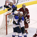 St Louis Blues' David Backes (42) and T.J. Oshie (74) celebrate in front of Phoenix Coyotes goaltender Mike Smith (41) after a goal by Blues' teammate Kevin Shattenkirk, not pictured, during the third period of an NHL hockey game, Sunday, March 2, 2014, i
