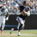 CORRECTS TO BEARS QUARTERBACK JAY CUTLER NOT JIMMY CLAUSEN - Chicago Bears quarterback Jay Cutler, right, scrambles past Carolina Panthers' Charles Johnson (95) during the first half of an NFL football game in Charlotte, N.C., Sunday, Oct. 5, 2014 The Ass