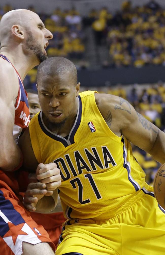 Indiana Pacers forward David West, right, drives on Washington Wizards center Marcin Gortat during the second half of game 1 of the Eastern Conference semifinal NBA basketball playoff series in Indianapolis, Monday, May 5, 2014. The Wizards defeated the Pacers 102-96