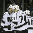 Los Angeles Kings left wing Dwight King (74) is congratulated by defenseman Jake Muzzin after assisting on a goal by right wing Justin Williams against the San Jose Sharks during the second period of an NHL preseason hockey game in San Jose, Calif., Tuesd