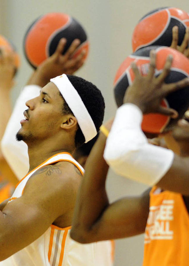 In this Oct. 2, 2013, photo Tennessee forward Jarnell Stokes, left, takes part in a practice drill in Knoxville, Tenn. Stokes received some brutally honest feedback when he considered entering the NBA Draft after his sophomore season. He took that criticism to heart during the offseason by losing weight and developing a more well-rounded game