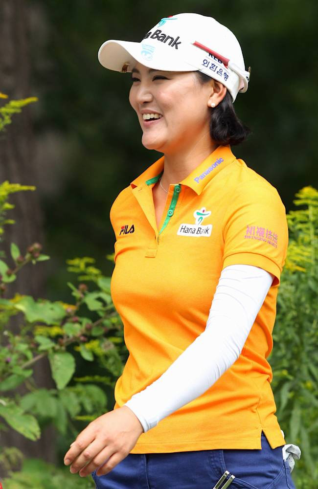 So Yeon Ryu, of South Korea, smiles as she walks to the eighth hole during final-round play at the Canadian Pacific Women's Open golf tournament in London, Ontario, Sunday, Aug. 24, 2014