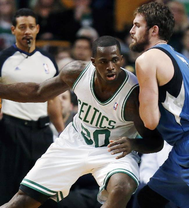 Boston Celtics' Brandon Bass (30) moves against Minnesota Timberwolves' Kevin Love (42) in the first quarter of an NBA basketball game in Boston, Monday, Dec. 16, 2013