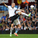 Aston Villa's Grant Holt, rear, and Fulham's Brede Hangeland battle for the ball during the English Premier League soccer match at Villa Park, Birmingham, England, Saturday April 5, 2014