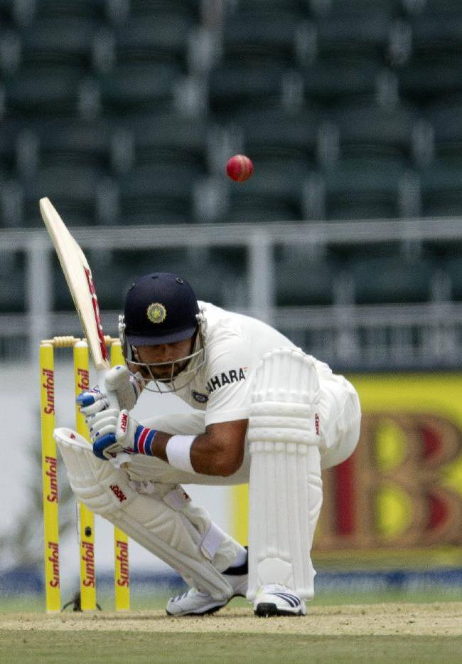 India's batsman Virat Kohli avoids a bouncer from South Africa's bowler Morne Morkel during the first day of their cricket test match at Wanderers stadium in Johannesburg, South Africa, Wednesday, Dec. 18, 2013