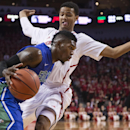 Florida Gulf Coast guard Jamail Jones, drives past Nebraska guard Shavon Shields, rear, in the first half of an NCAA college basketball game in Lincoln, Neb., Friday, Nov. 8, 2013 The Associated Press