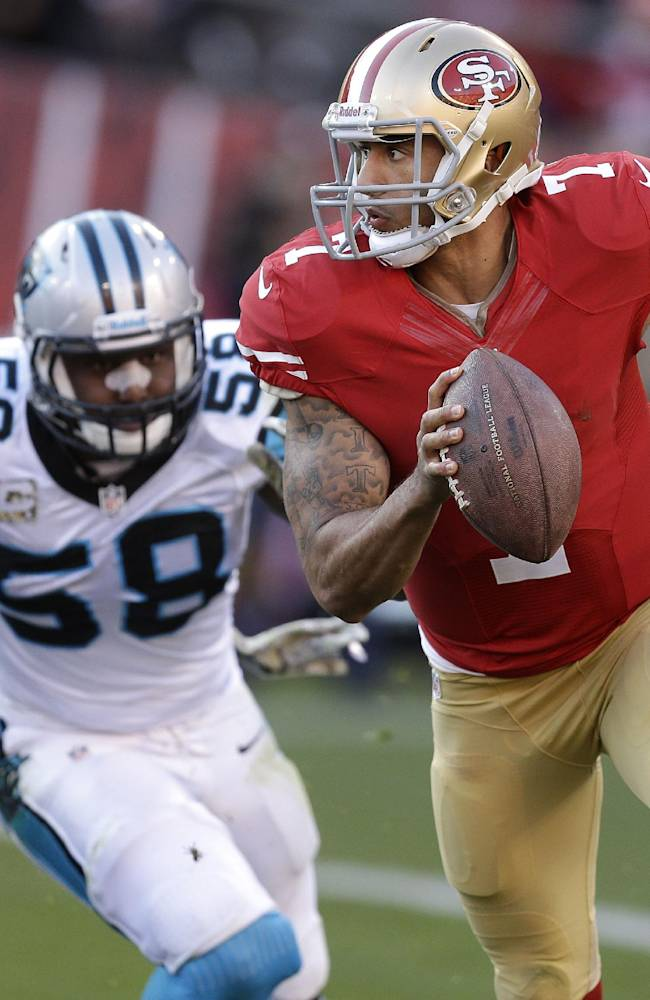 San Francisco 49ers quarterback Colin Kaepernick (7) runs from Carolina Panthers outside linebacker Thomas Davis (58) during the fourth quarter of an NFL football game in San Francisco, Sunday, Nov. 10, 2013