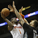 Minnesota Timberwolves' Nikola Pekovic, right, of Montenegro, tries to block a shot by New York Knicks' Amar'e Stoudemire in the second half of an NBA basketball game, Wednesday, March 5, 2014, in Minneapolis. The Knicks won 118-106 The Associated Press