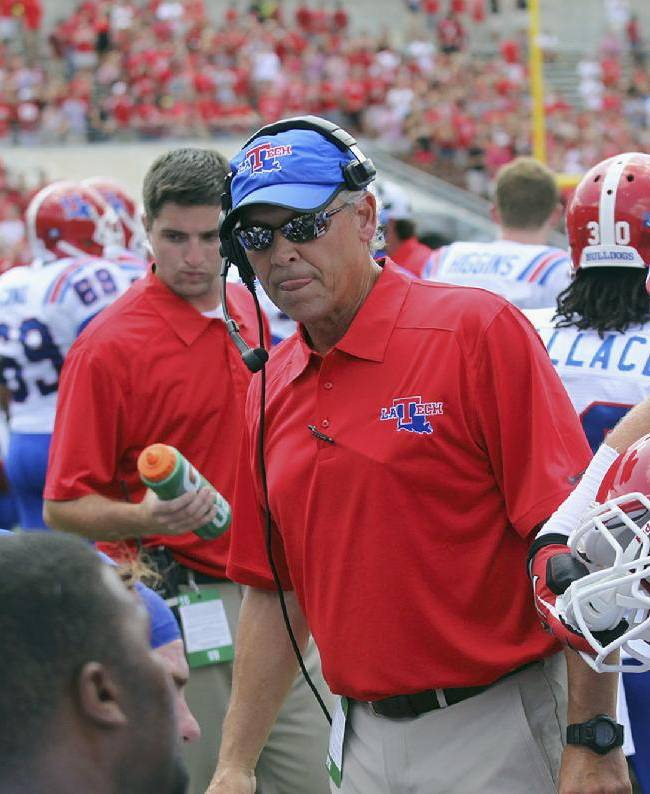 This Aug. 31, 2013 photo provided by Louisiana Tech University shows Louisiana Tech defensive coordinator Kim Dameron on the sidelines during an NCAA football game against North Carolina State in Raleigh, N.C. On Friday, Jan. 10, 2014, Eastern Illinois University announced that Dameron has been hired as its new head football coach, replacing Dino Babers who became head coach at Bowling Green. Dameron has never been a head coach. He spent last season at Louisiana Tech after working as Cornell's defensive coordinator in 2012