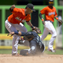 Miami Marlins second baseman Donovan Solano (17) tags Seattle Mariners runner Robinson Cano (22) out, stealing at second on eighth inning of a baseball game in Miami, Sunday, April 20,2014. The Marlins won 3-2 The Associated Press