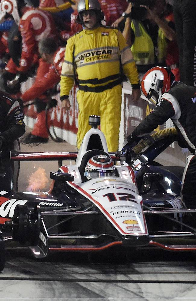 Will Power makes his first pit stop during the IndyCar Series season final 500 mile auto race Saturday, Aug. 30, 2014, at Auto Club Speedway, in Fontana, Calif