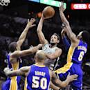 San Antonio Spurs guard Marco Belinelli shoots between Los Angeles Lakers, from left, Xavier Henry, Robert Sacre and Kent Bazemore during the first half of an NBA basketball game Friday, March 14, 2014. (AP Photo/Bahram Mark Sobhani)