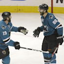 San Jose Sharks right wing Brent Burns (88) celebrates with Joe Thornton (19) after scoring a goal against Edmonton Oilers during the third period of an NHL hockey game Tuesday, April 1, 2014, in San Jose, Calif. San Jose won 5-4 The Associated Press