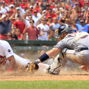 St. Louis Cardinals' Tommy Pham, left, scores past San Diego Padres catcher Derek Norris during the eighth inning of a baseball game Saturday, July 4, 2015, in St. Louis. The Cardinals won 2-1. (AP Photo/Jeff Roberson)