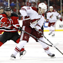 Phoenix Coyotes center Martin Hanzal, right, of the Czech Republic, competes for the puck with New Jersey Devils defenseman Andy Greene during the first period of an NHL hockey game, Thursday, March 27, 2014, in Newark, N.J The Associated Press