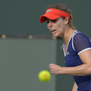 Alize Cornet, of France, reacts after winning a point in a fourth round match against Agnieszka Radwanska, of Poland, at the BNP Paribas Open tennis tournament, Tuesday, March 11, 2014, in Indian Wells, Calif. (AP Photo/Mark J. Terrill)