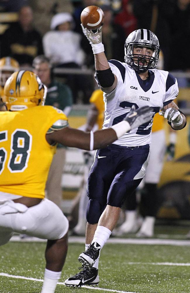 New Hampshire running back Nico Steriti (22) throws the ball past Southeastern Louisiana linebacker Dereck Robinson (58) during the second half of an NCAA college football Division 1 championship quarterfinal game in Hammond, La., Saturday, Dec. 14, 2013. New Hampshire won 20-17