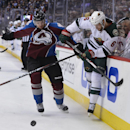 Colorado Avalanche defenseman Nate Guenin (5) checks Minnesota Wild defenseman Marco Scandella (6) into the boards in the first period of Game 2 of an NHL hockey first-round playoff series on Saturday, April 19, 2014, in Denver The Associated Press
